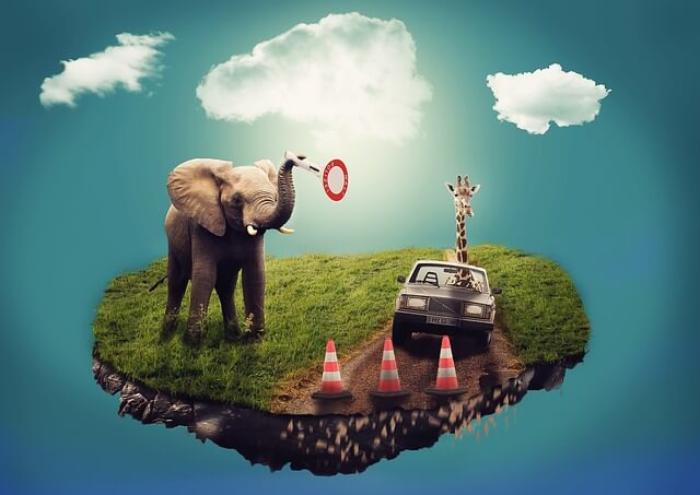 Na fruwającej wyspie stoi słoń, żyrafa jedzie autem